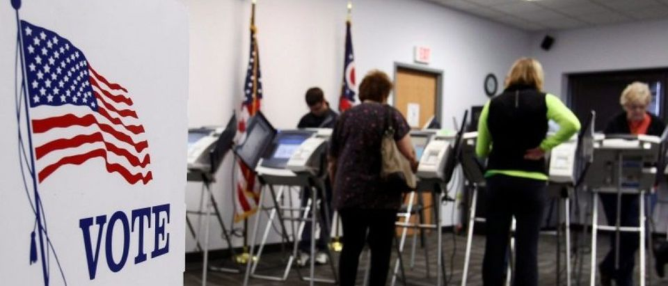 Ohio voters cast their votes at the polls for early voting in the 2012 U.S. presidential election in Medina Ohio