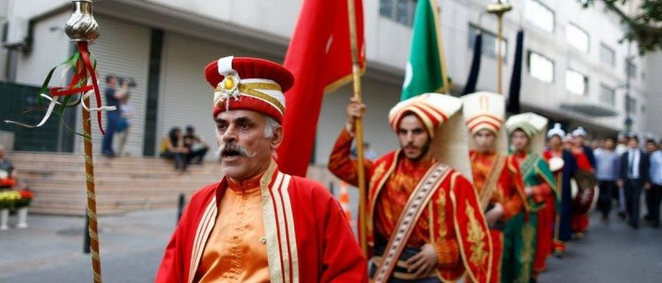 "Members of traditional Ottoman band Mehter perform near the German Consulate in Istanbul during a protest against approval of a resolution by Germany's parliament that declares the 1915 massacre of Armenians by Ottoman forces a ""genocide"""