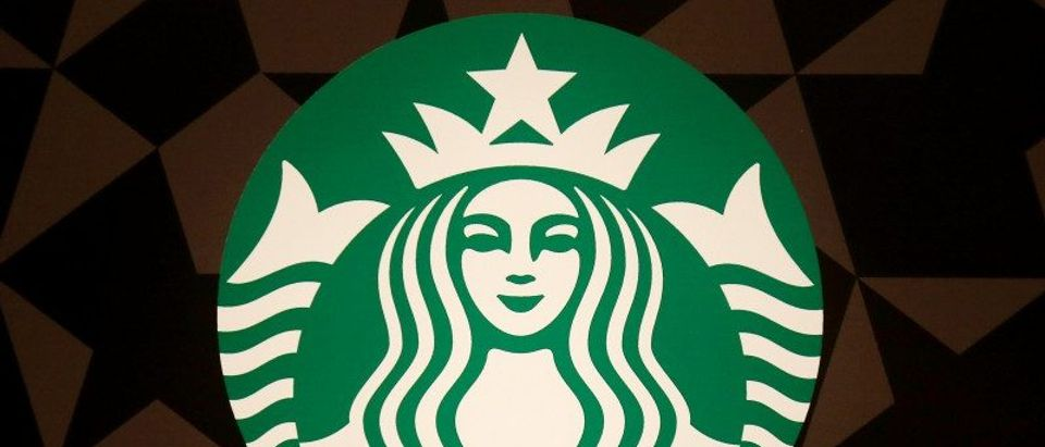 A Starbucks logo is pictured on the door of the Green Apron Delivery Service at the Empire State Building in New York