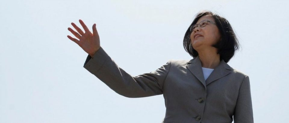 Taiwanese President Tsai Ing-wen waves her hand as she boards the nation's first domestically built 500-ton Tuo Jiang twin-hull stealth missile corvette at Suao Naval Base in Yilan