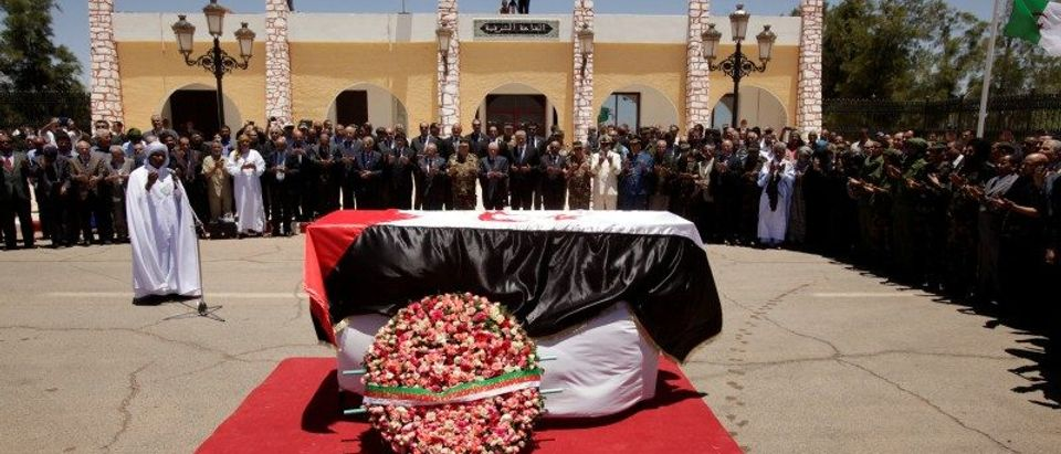 Officials and attendees pray over the coffin of Western Sahara's Polisario Front leader Mohamed Abdelaziz during his funeral in Tindouf