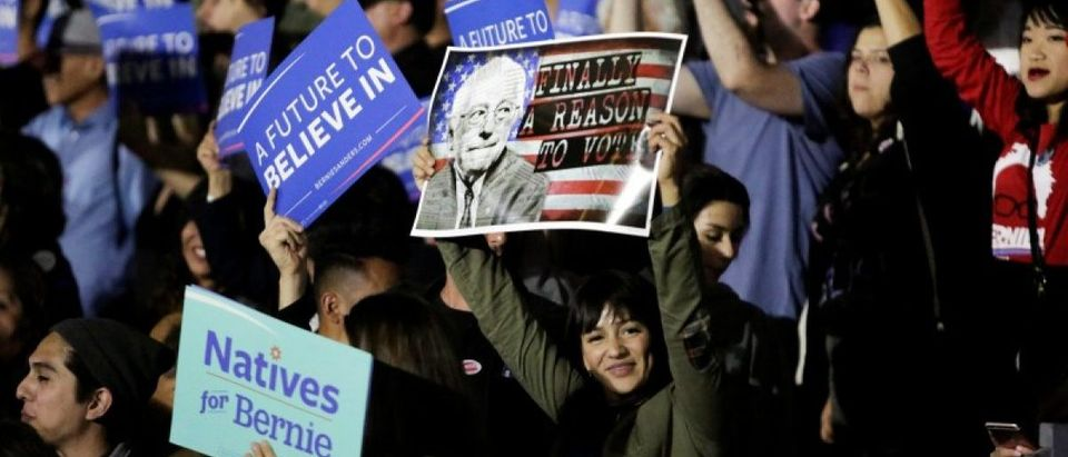 Supporters gather to see U.S. Democratic presidential candidate Bernie Sanders speak during a election night rally in Santa Monica, California, U.S. June 7, 2016. REUTERS/Jason Redmond