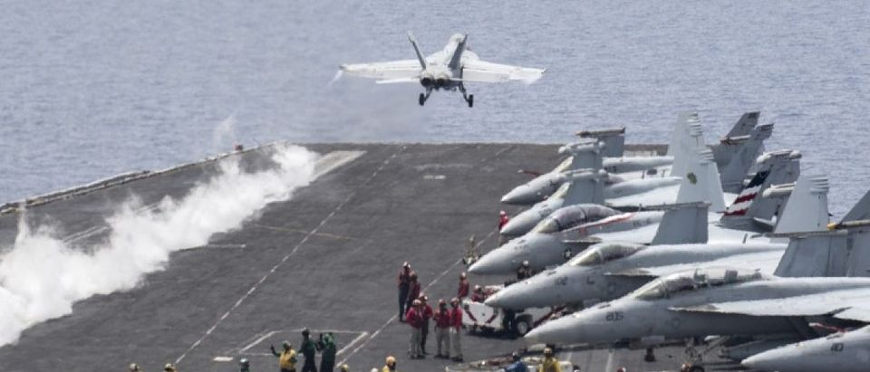 A U.S. Navy F/A-18E Super Hornet fighter jet launches from the flight deck of the aircraft carrier USS Harry S. Truman in the Mediterranean Sea