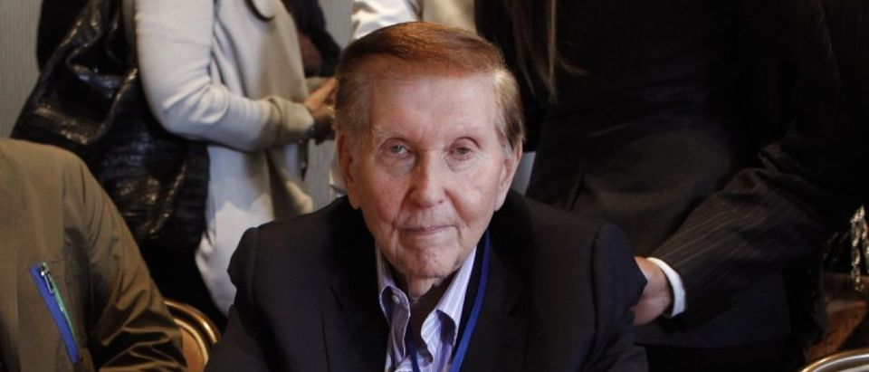 Redstone poses for a photo at the Milken Institute Global Conference in Beverly Hills, California