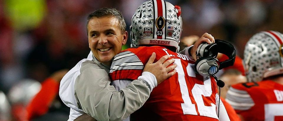 Head coach Urban Meyer of the Ohio State Buckeyes hugs Quarterback Cardale Jones #12 in the fourth quarter against the Oregon Ducks during the College Football Playoff National Championship Game at AT&T Stadium on January 12, 2015