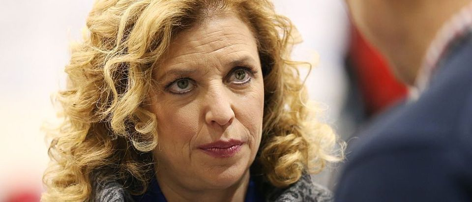 Representative Debbie Wasserman Schultz (D-FL 23rd District) and chair of the Democratic National Committee (DNC) speaks to a reporter before the democratic debate on December 19, 2015 in Manchester, New Hampshire. (Photo by Andrew Burton/Getty Images)