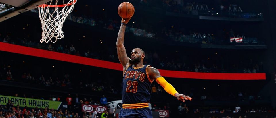 LeBron James of the Cleveland Cavaliers dunks against the Atlanta Hawks at Philips Arena on April 1, 2016 in Atlanta