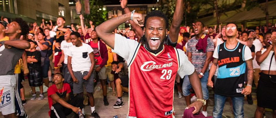 Fans react to a play during the Cleveland Cavaliers NBA Finals Game Seven watch party at Quicken Loans Arena