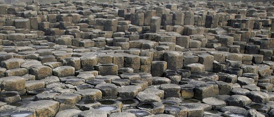 Tourist visits the Giant's Causeway landscape in the northeast coast of Northern Ireland