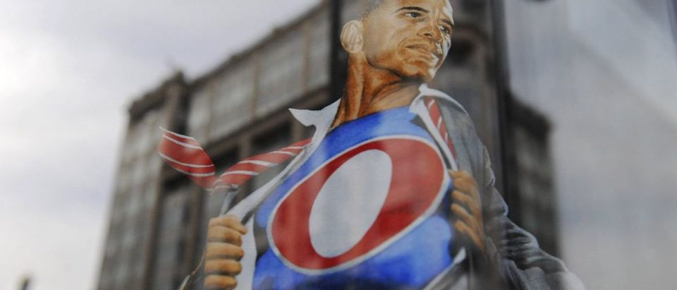 A t-shirt with a depiction of Obama as a comic book superhero hangs in a shop window ahead of Obama's inauguration, in Washington