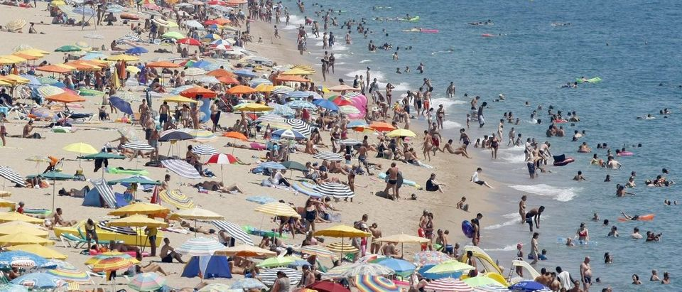 People cool off in the Mediterranean sea at Calella's beaches, north of Barcelona