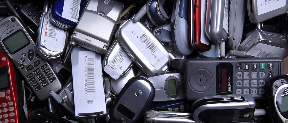 Hundreds of used cellphones sit waiting to be recycled at the offices of ECO ATM, a start-up company, in San Diego