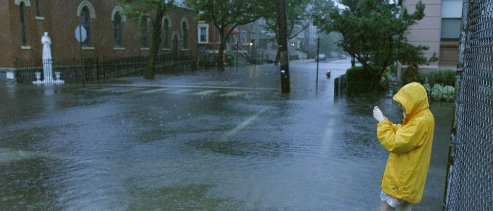 Woman takes pictures of flooded streets through the rain in Hoboken in New Jersey