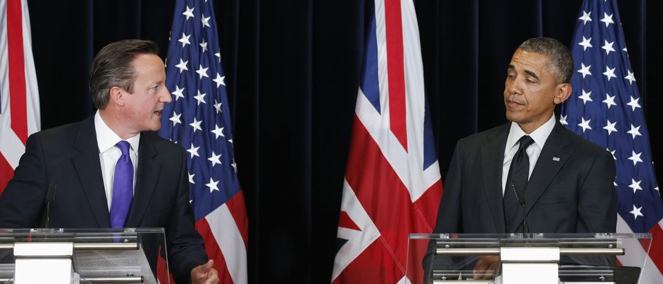 U.S. President Barack Obama reacts to a witty comment from British Prime Minister David Cameron during a news conference at the G7 Summit in Brussels