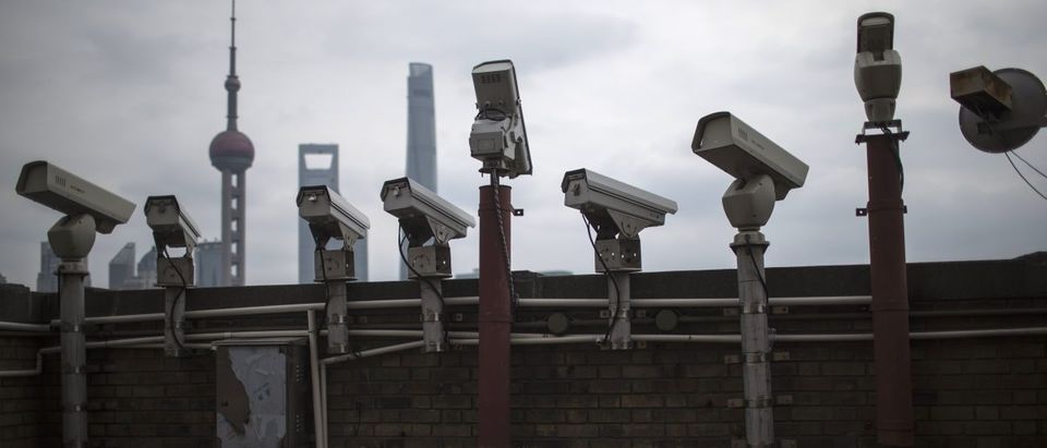 Security cameras are seen on a building at the Bund in front of the financial district of Pudong in Shanghai