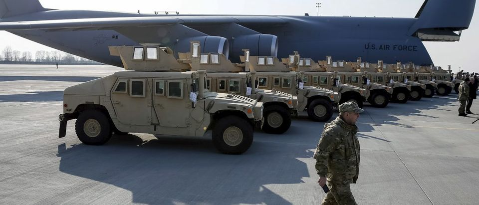 Ukrainian servicemen take part in a welcome ceremony for first plane from United States with non-lethal aid including ten Humvee vehicles at Borispol airport near Kiev