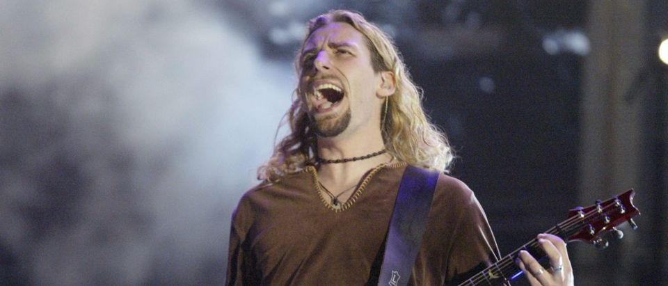 """Chad Croeger, lead singer of the Canadian group """"Nickelback,"""" performs onstage at the 30th annual American Music Awards in Los Angeles, January 13, 2003"""