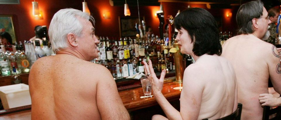 Clothing optional dinner participants at New York City restaurant for naked dining.