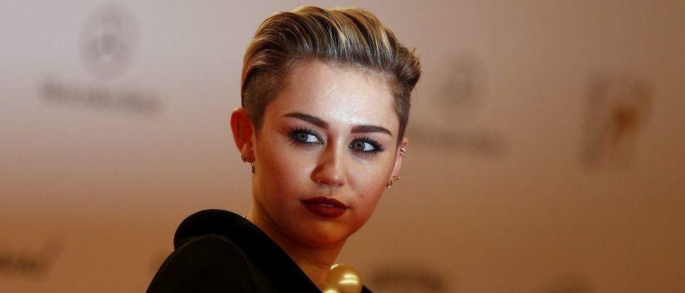 U.S. singer singer Miley Cyrus arrives on the red carpet for the Bambi 2013 media awards ceremony in Berlin November 14, 2013. REUTERS/Tobias Schwarz
