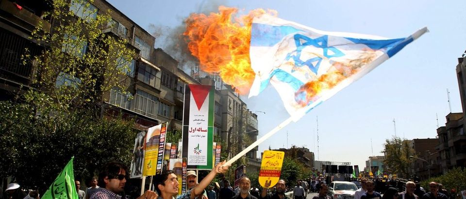 Iranian demonstrators burn an Israeli flag during a rally marking al-Quds (Jerusalem) Day in Tehran