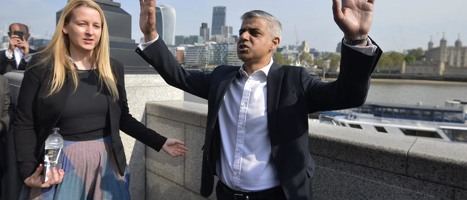 Britain's newly elected mayor Sadiq Khan speaks to supporters as he arrives for his first day at work at City Hall in London, Britain May 9, 2016. REUTERS/Hannah McKay