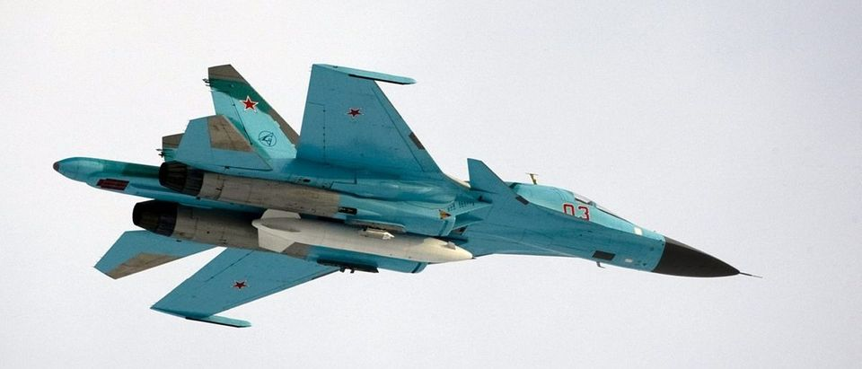 A Sukhoi SU-34 fighter-bomber with Russia's President Dmitry Medvedev on board is airborne over the Kubinka airbase outside Moscow