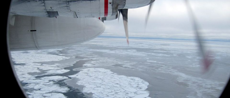 Broken Arctic sea ice as seen from a window in from a U.S. Coast Guard C130 flight over the Arctic Ocean