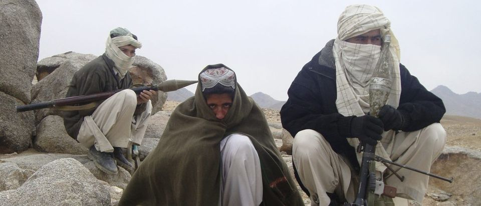 Taliban fighters pose with weapons in an undisclosed location in Afghanistan