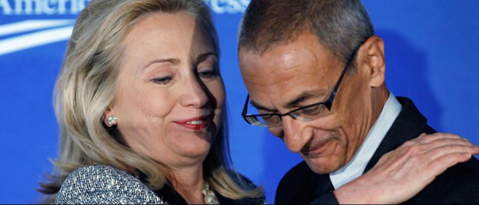 John Podesta and Hillary Clinton; October 12, 2011. PHOTOGRAPH BY CHIP SOMODEVILLA / GETTY