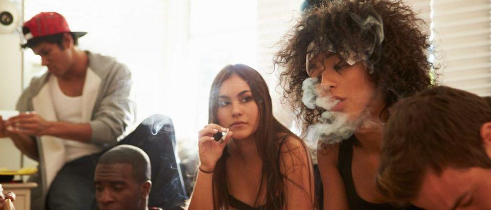 Teens smoking marijuana (Credit: Shutterstock/Monkey Business Images)