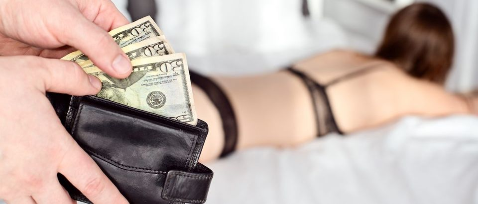 The man pays a prostitute with american money dollar
