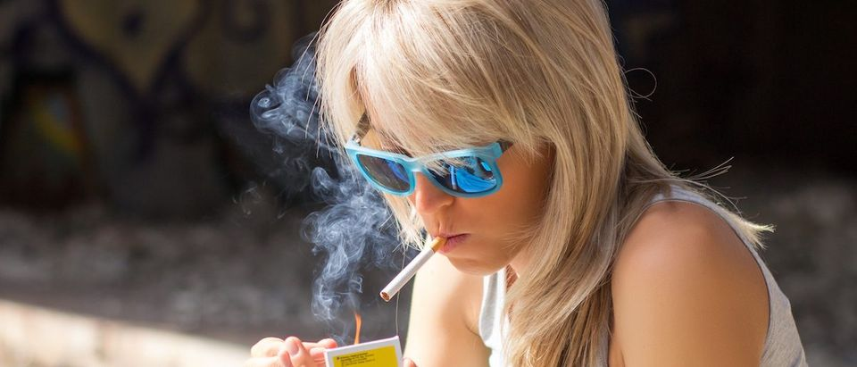 Young Woman Smoking (Shutterstock/Kaspars Grinvalds)