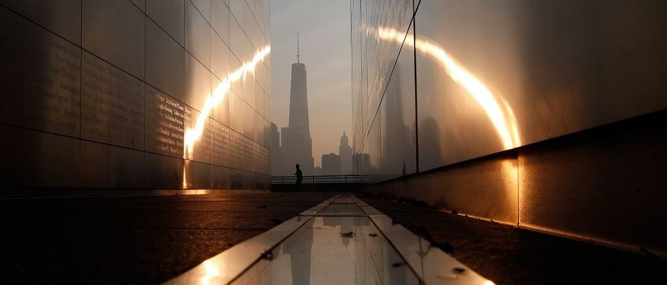 A man runs past the 9/11 Empty Sky memorial across from New York's Lower Manhattan and One World Trade Center in Liberty State Park in Jersey City(Photo: REUTERS/Gary Hershorn)