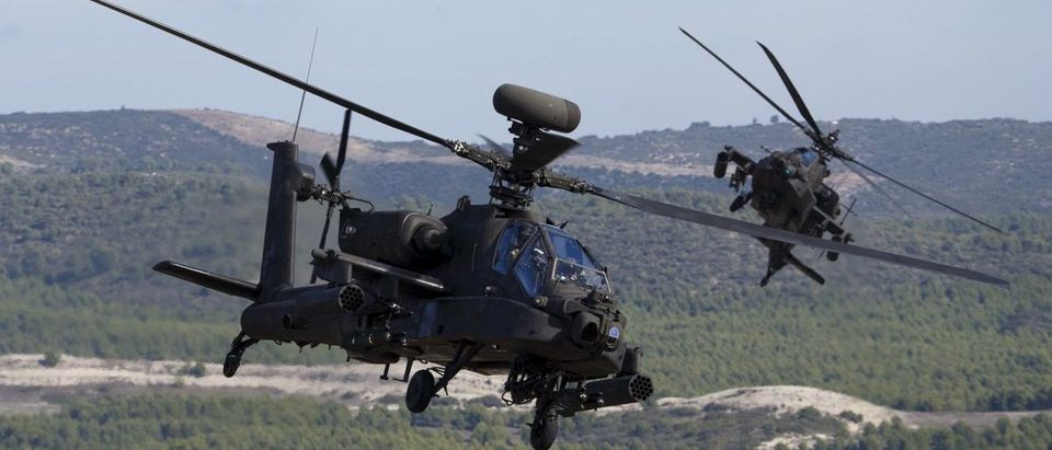 NATO forces in AH-64 Apache helicopters take part in Exercise Trident Juncture 2015, NATO's largest joint and combined military exercise in more than a decade, at the San Gregorio training grounds outside Zaragoza