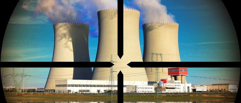Nuclear power plant in a terrorist's weapon gunsight (Shutterstock.com/Kletr)