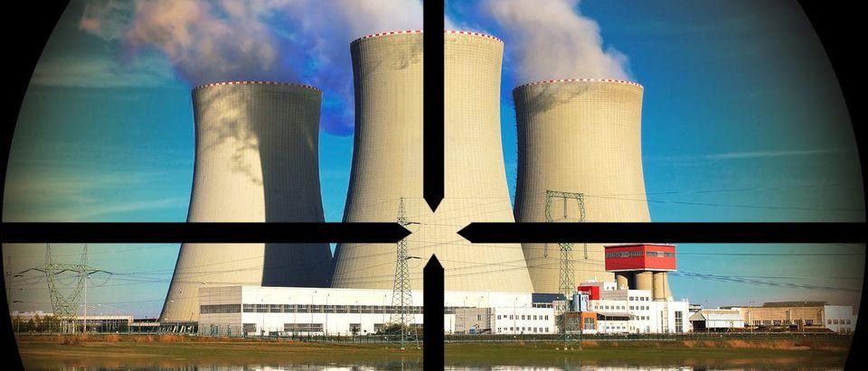 Nuclear power plant in a terrorist's weapon gunsight (Shutterstock.com/Kletr)