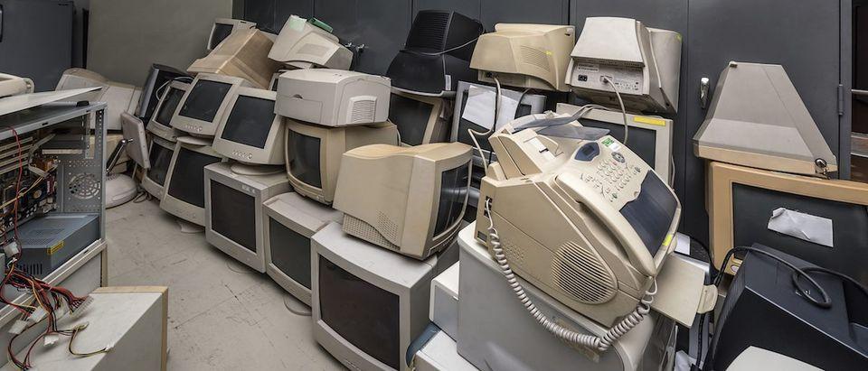 Piles of old computers in office building Photo: Shutterstock