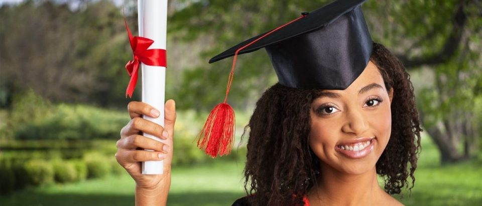 college grad. [Shutterstock/Billion Photos]