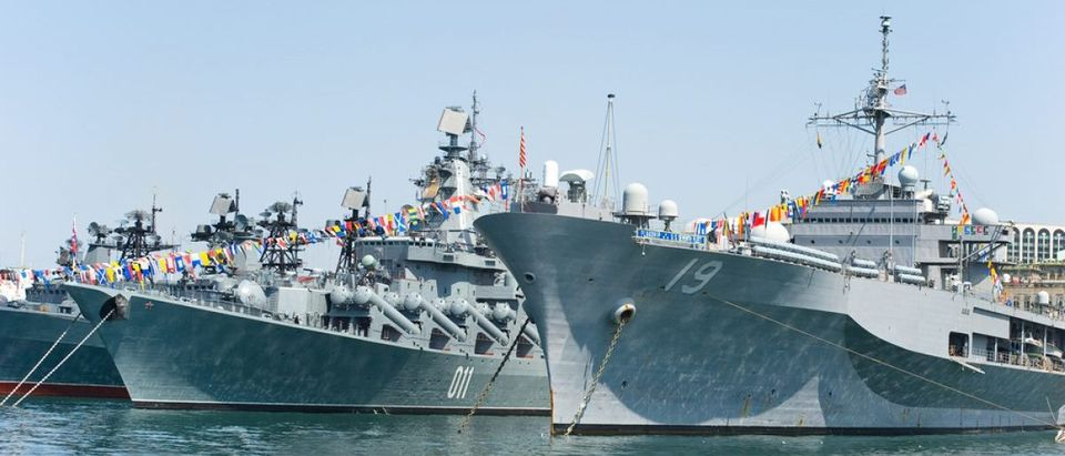 visit of US navy 7th Fleet flagship in the russia Vladivostok near the russian frigate (Credit: Maxim Tupikov/Shutterstock)