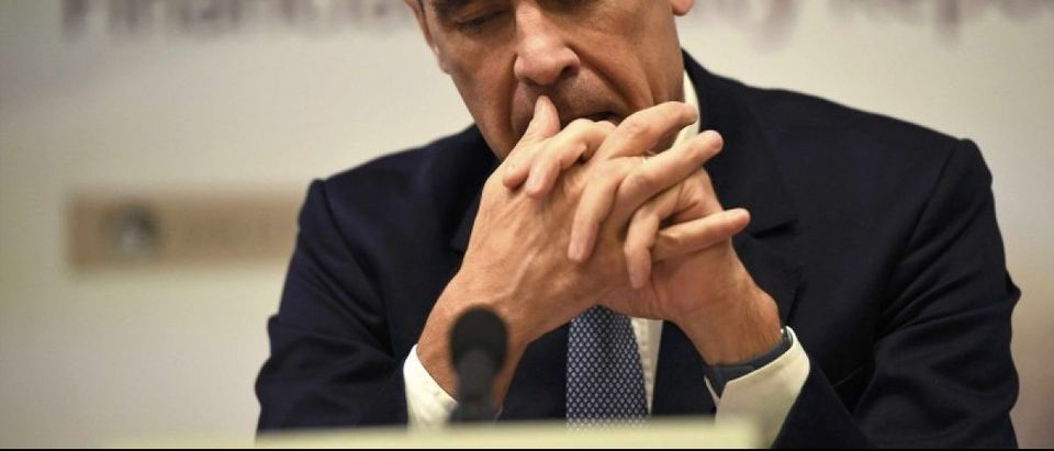 Bank of England governor Mark Carney pauses as he speaks during a news conference at the Bank of England in London