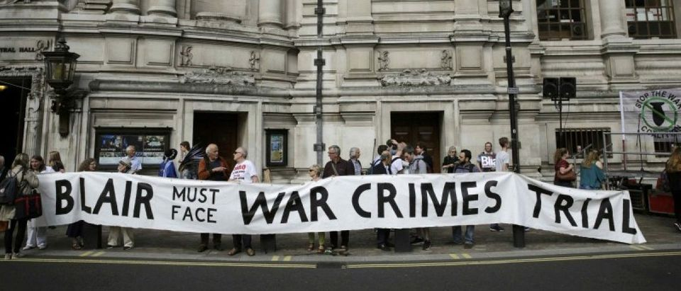 Demonstrators protest before the release of the John Chilcot report into the Iraq war, at the Queen Elizabeth II centre in London