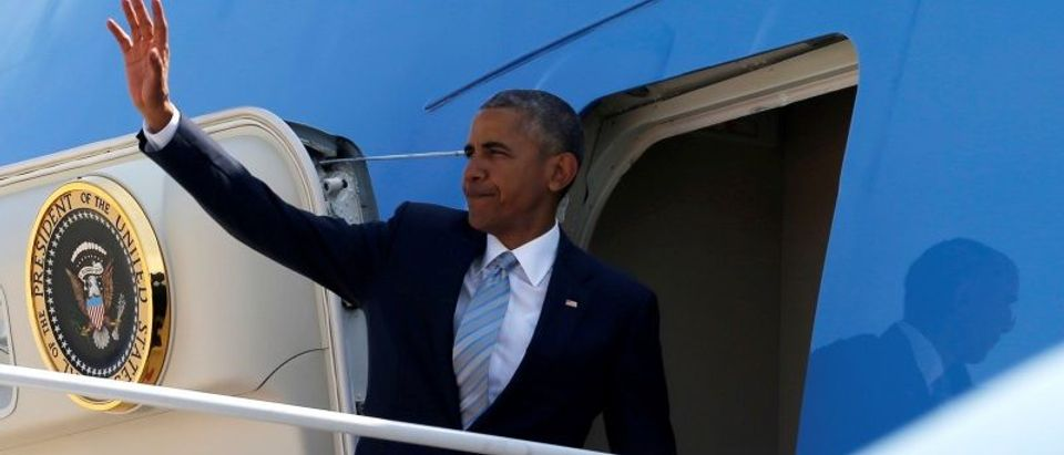 Obama boards Air Force One for travel to Poland for a summit with fellow NATO heads of state, from Joint Base Andrews, Maryland, U.S.