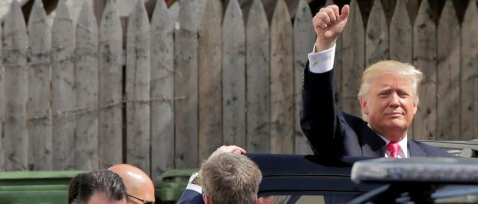 Republican U.S. presidential candidate Donald Trump waves after meeting with House Republican members in Washington