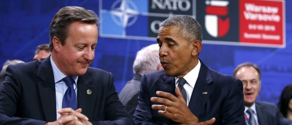 U.S. President Barack Obama speaks to British Prime Minister David Cameron during the NATO Summit in Warsaw, Poland July 8, 2016. REUTERS/Kacper Pempel