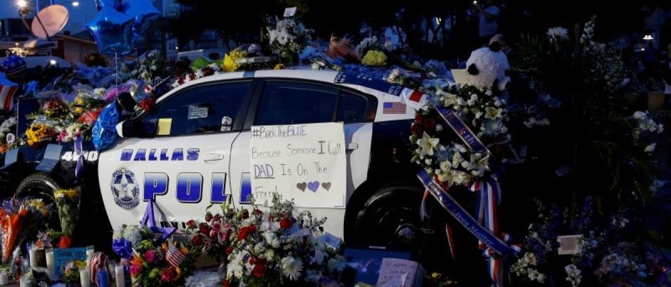 A makeshift memorial at Dallas Police Headquarters is seen one day after a lone gunman ambushed and killed five police officers at a protest decrying police shootings of black men, in Dallas. REUTERS/Shannon Stapleton