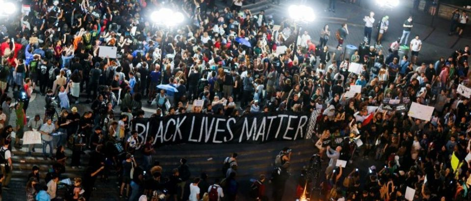 People take part in a protest against police brutality and in support of Black Lives Matter during a march in New York July 9, 2016. REUTERS/Eduardo Munoz