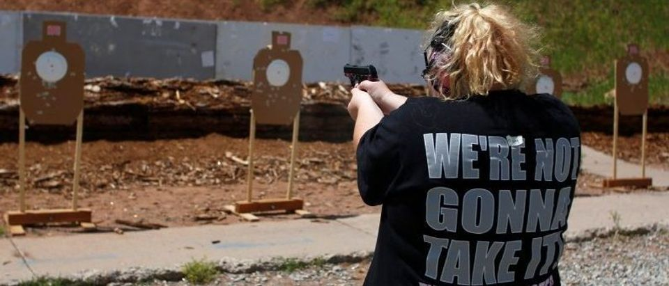Mallory Washburn shoots at targets during a firearms training class attended by members of the Pink Pistols, a national pro-gun LGBT organization, at the PMAA Gun Range in Salt Lake City