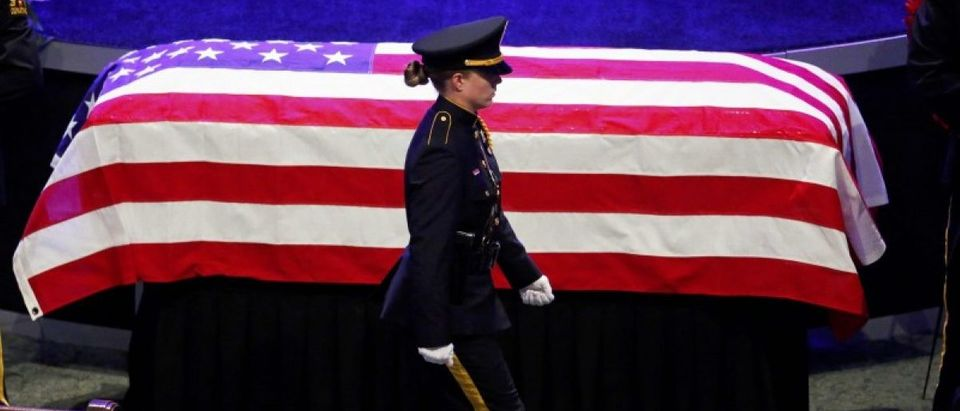 Police officers pay their respects ahead of the funeral for Officer Lorne Ahrens in Plano