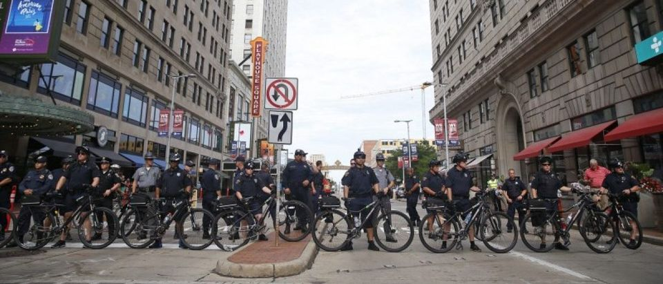"""Police block a downtown street with their bicycles during a march by various groups, including """"Black Lives Matter"""" and """"Shut Down Trump and the RNC"""". REUTERS/Shannon Stapleton"""