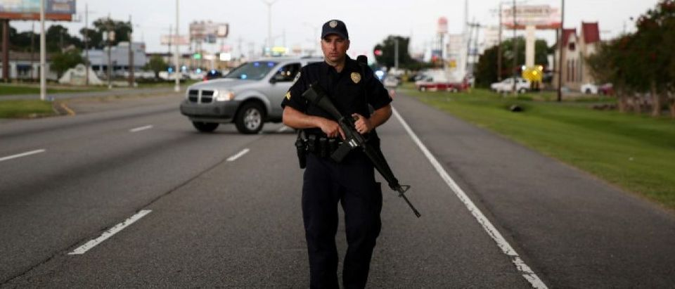 A police officer blocks off a road near the scene of a fatal shooting of police officers in Baton Rouge, Louisiana, United States, July 17, 2016. REUTERS/Joe Penney